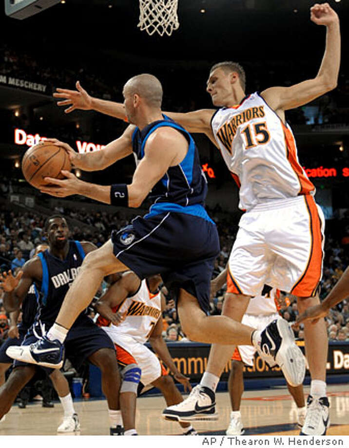Dallas Mavericks' Jason Kidd (2) is pressured under the basket by Golden State Warriors' Andris Biedrins (15), of Latvia, during first quarter action of an NBA basketball game in Oakland, Calif., Sunday, March 30, 2008.(AP Photo/Thearon W. Henderson) Photo: Thearon Henderson