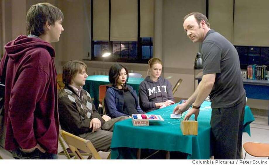 """In Columbia Pictures� 21, the M.I.T. blackjack team ? a group of students that has figured out how to take Vegas for millions ? practices counting cards. Left to right: Ben Campbell (Jim Sturgess), Fisher (Jacob Pitts), Kianna (Liza Lapira), Jill Taylor (Kate Bosworth), Micky Rosa (Kevin Spacey). Directed by Robert Luketic, the screenplay is by Peter Steinfeld and Allan Loeb, based upon the book """"Bringing Down the House"""" by Ben Mezrich. The producers are Dana Brunetti, Kevin Spacey, and Michael De Luca. The film opens in theaters nationwide on March 28, 2008. Photo: Peter Iovino"""