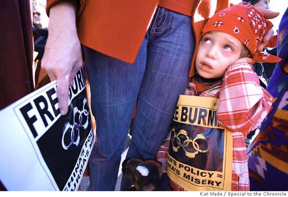Isaac Frierman, 3, covers his ears as the crowd loudly chats free Burma before Burmese monk, Ashin Nanikabhivamsa leads a meditative peace walk across the Goloden Gate Bridge in San Francisco, Calif. on Wednesday, April 9, 2008.  Photo by Kat Wade / Special to the Chronicle Ran on: 04-10-2008  Isaac Frierman, 3, covers his ears while the crowd chants before a Burmese monk leads a peace walk across the Golden Gate Bridge. Photo: Kat Wade