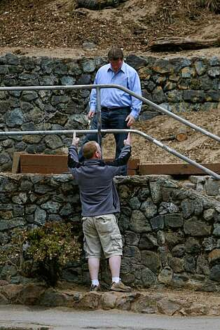 Seamus Cudden (bottom), a General Building Contractor volunteering his time on the horseshoe court restoration project, talks with Steve Flannery (top), superintendent of structural maintenance with the San Francisco Recreation and Parks, discuss work to be done at the horseshoe courts in Golden Gate Park on Tuesday August 11, 2009 in San Francisco, Calif. Photo: Lea Suzuki, The Chronicle