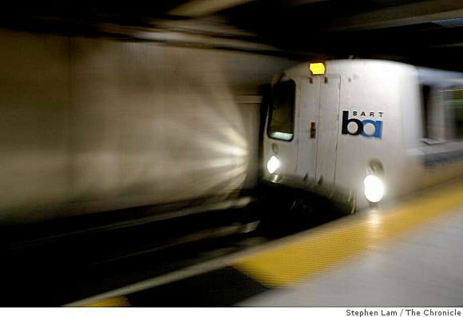 A BART train arrives at at Embarcadero station during early morning rush hours in San Francisco Monday morning, June 29, 2009. BART and its two largest unions have agreed to extend labor contract through July 9 to continue ongoing new contract negotiations and forestall possible strike which would cripple the regions traffic and public transportation system. BART currently carries approximately 355,000 riders on a daily basis. Photo: Stephen Lam, The Chronicle
