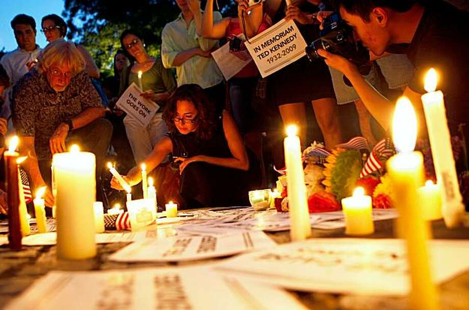 WASHINGTON - AUGUST 26:  People participate during a candlelight vigil in memory of U.S. Sen. Edward Kennedy (D-MA) at Dupont Circle August 26, 2009 in Washington, DC. Kennedy has passed away at the age of 77 at his home in Hyannis Port, Massachusetts after battling a brain cancer.  (Photo by Alex Wong/Getty Images) Photo: Alex Wong, Getty Images