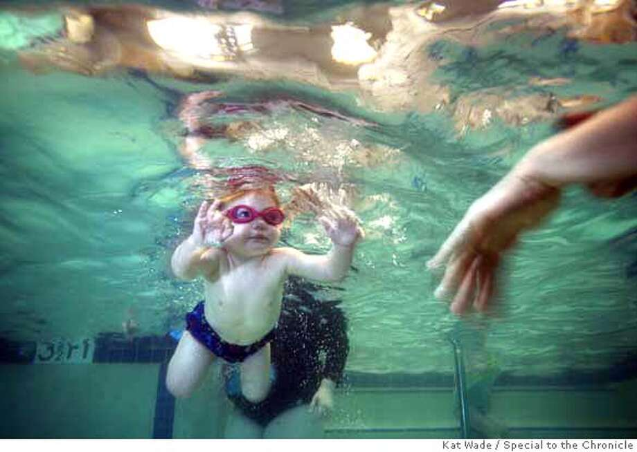 Her favorite part of the class, Rosa Beckert, 2-yrs., swims with no fear to her mom, Rachel Beckert in the infants swimming class taught by Catrina Patane at La Petite Baleen in San Bruno, Calif. on Friday, March 21, 2008.  Photo by Kat Wade / Special to the Chronicle Ran on: 03-28-2008  Two-year-old Rosa Beckert swims to mom Rachel Beckert at La Petite Baleen in San Bruno. Photo: Kat Wade