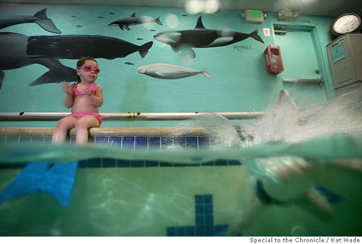 Kaylee Ellerhost, left, applauds classmate Rosa Beckert as she jumps into the pool during the infants swimming class taught by Catrina Patane at Lapetite Baleen in San Bruno, Calif. on Friday, March 21, 2008. Photo by Kat Wade / Special to the Chronicle Ran on: 03-28-2008 Kaylee Ellerhost applauds classmate Rosa Beckert as she jumps into the pool during swimming class. Ran on: 03-28-2008 Kaylee Ellerhost applauds classmate Rosa Beckert as she jumps into the pool during swimming class.