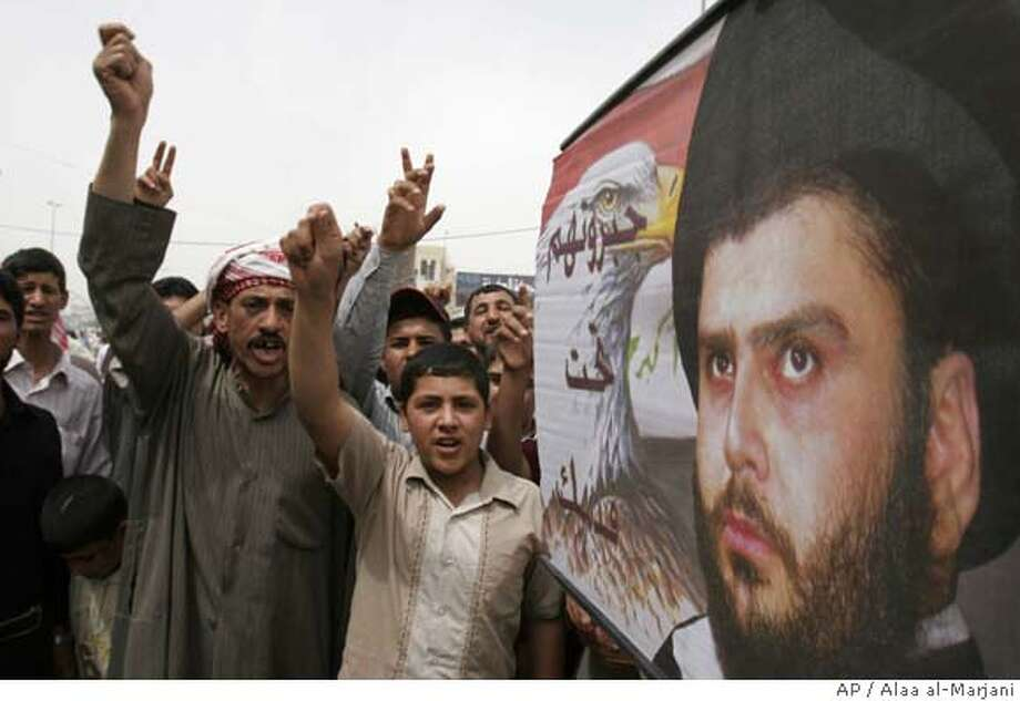 """###Live Caption:Iraqis chant after prayers, next to a poster of radical Shiite cleric Muqtada al-Sadr in Kufa, Iraq, Friday, March 28, 2008. Shiite militia leader Muqtada al-Sadr called on Thursday for a political solution to the burgeoning crisis and an end to the """"shedding of Iraqi blood."""" (AP Photo/Alaa al-Marjani)###Caption History:Iraqis chant after prayers, next to a poster of radical Shiite cleric Muqtada al-Sadr in Kufa, Iraq, Friday, March 28, 2008. Shiite militia leader Muqtada al-Sadr called on Thursday for a political solution to the burgeoning crisis and an end to the """"shedding of Iraqi blood."""" (AP Photo/Alaa al-Marjani)###Notes:###Special Instructions: Photo: ALAA AL-MARJANI"""