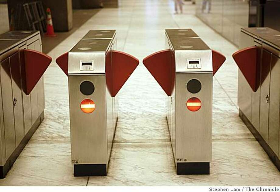 A BART turnstiles awaits the next wave of commuters at Embarcadero station during early morning rush hours in San Francisco Monday morning, June 29, 2009. BART and its two largest unions have agreed to extend labor contract through July 9 to continue ongoing new contract negotiations and forestall possible strike which would cripple the regions traffic and public transportation system. BART currently carries approximately 355,000 riders on a daily basis. Photo: Stephen Lam, The Chronicle