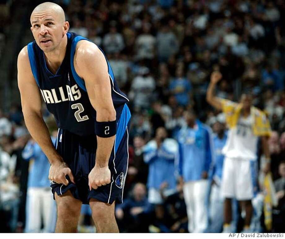 ###Live Caption:Dallas Mavericks guard Jason Kidd (2) reacts while members of the Denver Nuggets celebrate in the background as the Nuggets pulled ahead in the fourth quarter of their 118-105 victory in an NBA basketball game in Denver on Thursday, March 27, 2008. (AP Photo/David Zalubowski)###Caption History:Dallas Mavericks guard Jason Kidd (2) reacts while members of the Denver Nuggets celebrate in the background as the Nuggets pulled ahead in the fourth quarter of their 118-105 victory in an NBA basketball game in Denver on Thursday, March 27, 2008. (AP Photo/David Zalubowski)###Notes:Jason Kidd###Special Instructions:EFE OUT Photo: David Zalubowski