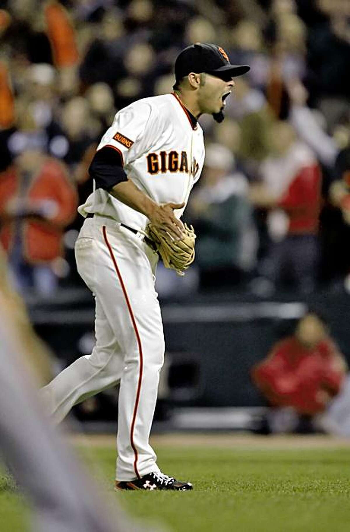 Sergio Romo reacts after closing the game against the Arizona Diamondbacks. The San Francisco Giants played the Arizona Diamondbacks at AT&T Park in San Francisco, Calif., on Tuesday, August 25, 2009. The Giants won the game, 5-4.