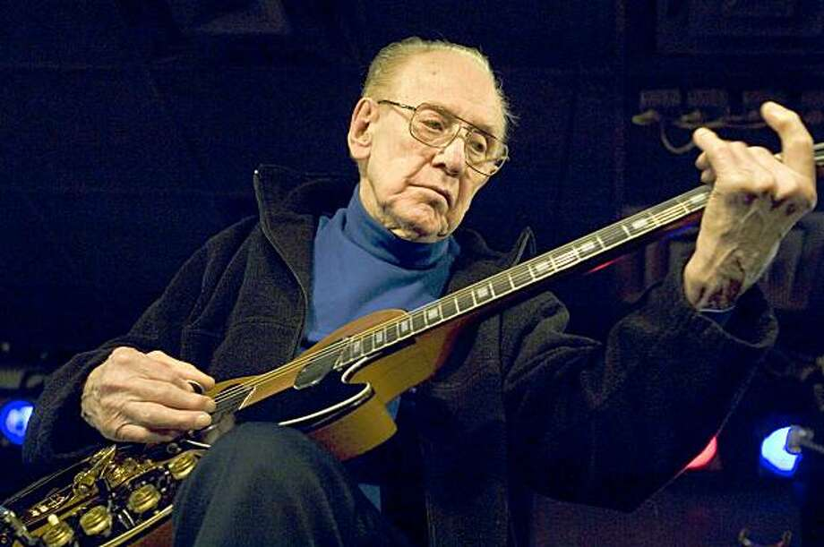 Guitar legend Les Paul performs at the Iridium Jazz Club in New York in 2007. Paul, 94, the guitarist and inventor who changed the course of music with the electric guitar and multitrack recording and had a string of hits, died on Aug. 13th in White Plains, N.Y.. Photo: Colin Archer, AP
