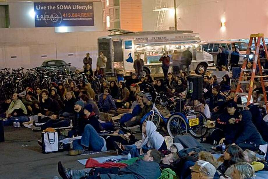 "Hundreds of people transformed an ordinary parking lot into a  into a festive, inviting Bike-In Movie  space during the screening for ""Rad.""    SONY DSC Photo: San Francisco Bicycle Coalition"