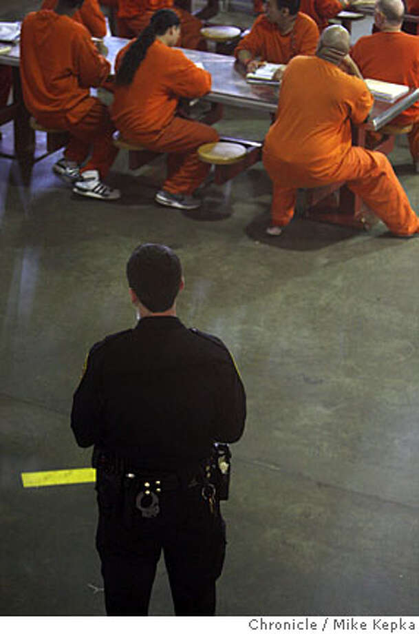 A Deputy Sheriff with the San Francisco Sheriff's Dept. watches over a group of inmates at the San Francisco County Jail West on Thursday, April, 3, 2008 in San Francisco, Calif. This county jail is becoming overcrowded and produces a large amount overtime work for deputies on duty there. Photo by Mike Kepka / San Francisco Chronicle Ran on: 04-07-2008  A deputy sheriff keeps watch over inmates at the overcrowded County Jail 5-West, brimming with inmates after the mayor called for a crackdown. Photo: Kepka, Mike