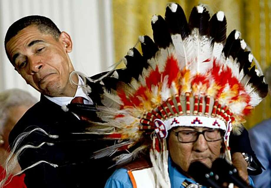 WASHINGTON - AUGUST 12:  U.S. President Barack Obama (L) struggles to present the Medal of Freedom to Dr. Joseph Medicine Crow - High Bird (R) during a ceremony at the White House August 12, 2009 in Washington, DC. The Medal of Freedom is the highest civilian award in the United States. Dr. Joseph Medicine Crow - High Bird was presented the medal for his valiant service in World War II where he was awarded the status of Crow War Chief, and his renowned studies of the First Americans and contributions to cultural and historical preservation have been critical to our understanding of America's history.  (Photo by Win McNamee/Getty Images) Photo: Win McNamee, Getty Images