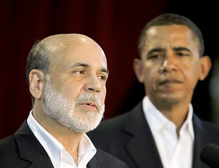 President Barack Obama looks on after announcing he is keeping Federal Reserve Board Chairman Ben Bernanke for a second term, Tuesday, Aug. 25, 2009, during a news conference in Oak Bluffs, Mass. (AP Photo/Stephan Savoia) Photo: Stephan Savoia, AP