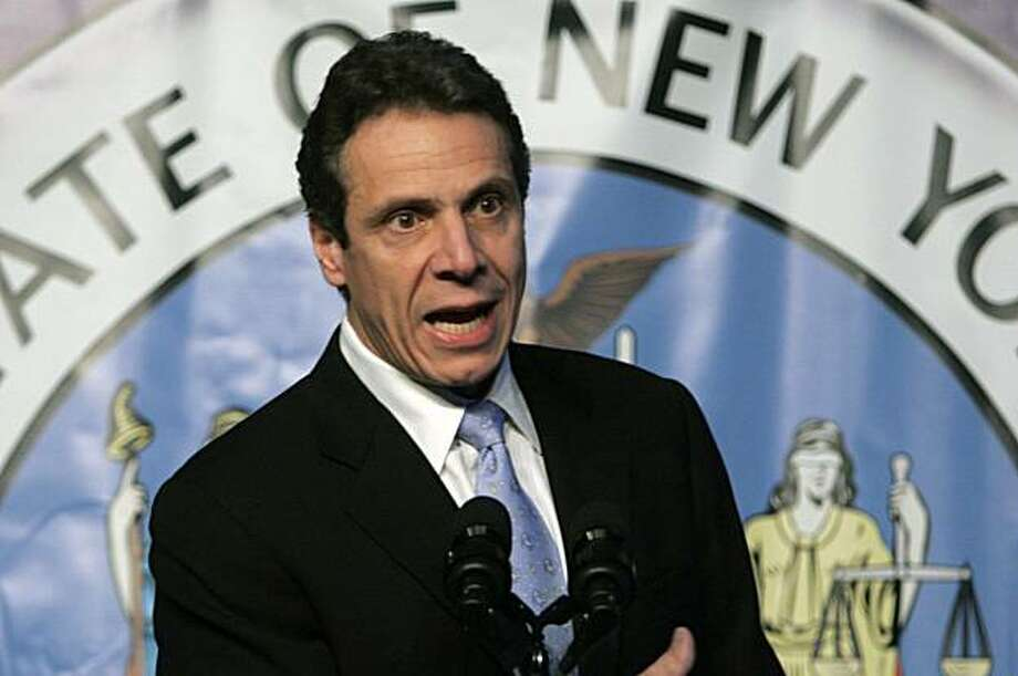 FILE - In this Dec. 11, 2008 file photo, New York Attorney General Andrew Cuomo speaks during a presentation in Albany, N.Y. Cuomo on Monday, Aug. 17, 2009 filed a lawsuit against the brokerage unit of Charles Schwab Corp., claiming the firm misled customers about the safety of auction-rate securities. (AP Photo/Mike Groll, file) Photo: Mike Groll, AP