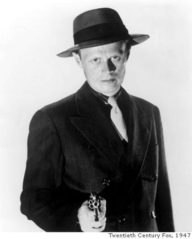 "(NYT8) NEW YORK -- March 26, 2008 -- Richard Widmark as Tommy Udo, a psychopathic killer in the 1947 gangster film ""Kiss of Death."" Widmark, whose portrayal of Udo in his first movie role was so repellent and frightening that the actor became a star overnight, died Monday, March 24, 2008 at his home in Roxbury, Conn. He was 93. His death was announced Wednesday morning by his wife, Susan Blanchard. (20TH Century Fox/The New York Times) Photo: 20TH CENTURY FOX"