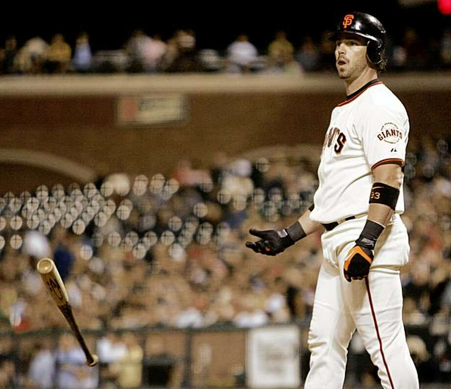 San Francisco Giants' Aaron Rowand tosses his bat after striking out with the bases loaded against the Arizona Diamondbacks during the fourth inning of a baseball game in San Francisco, Thursday, Aug. 27, 2009.(AP Photo/Marcio Jose Sanchez) Photo: Marcio Jose Sanchez, AP
