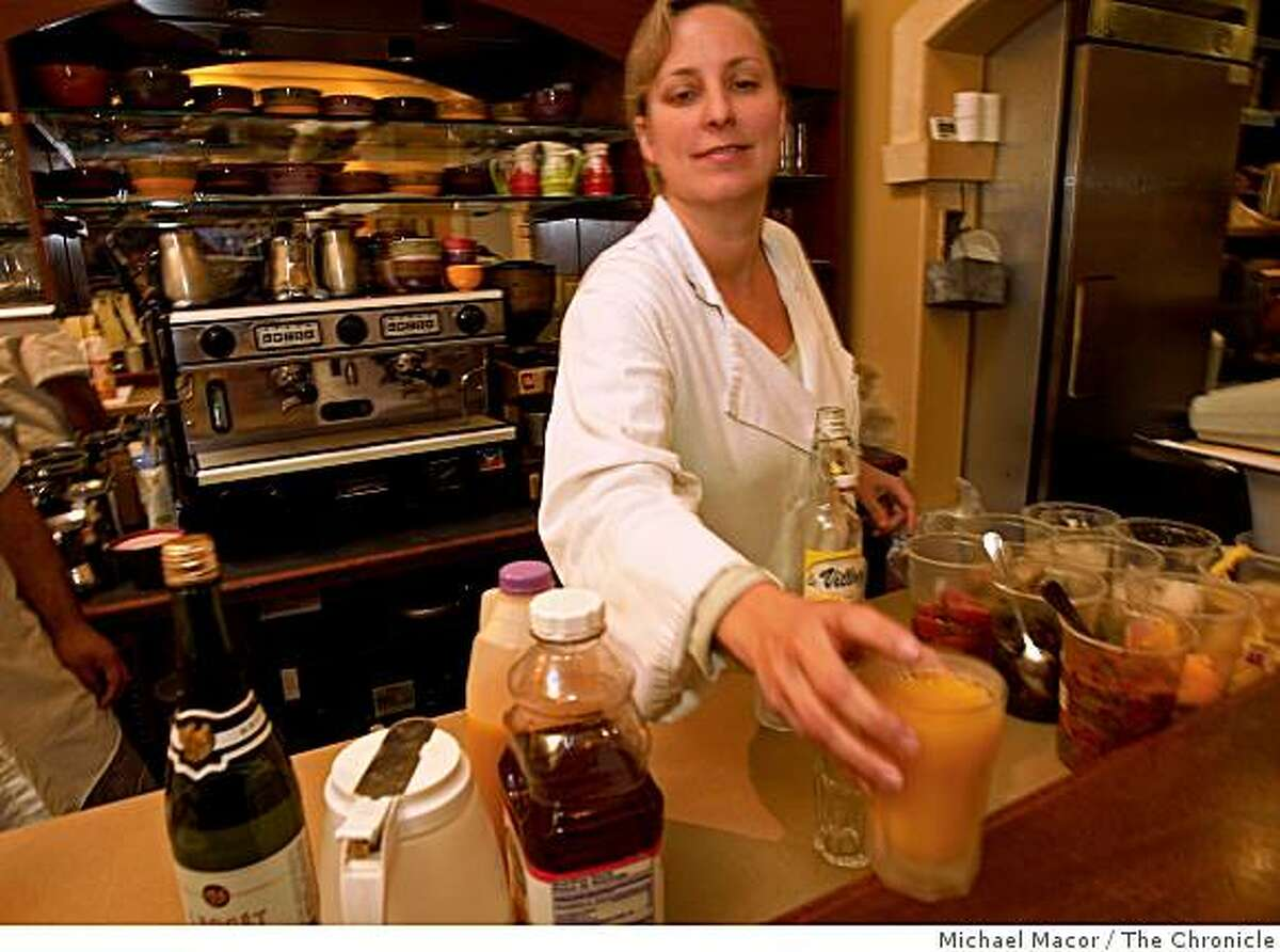 """Jennifer Paillet is the owner of """"Zazie"""" restaurant in the Cole Valley district of San Francisco, Calif. Paillet provides the required health care to her employees by adding a surcharge of $1 per customer onto each bill. Paillet working the counter making drinks for the lunch crowd, on Wednesday Jan. 14, 2009."""