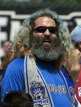 Earthquake soccer fan Jason Wiener (long hair) cheers his team on during a soccer match between the San Jose Earthquakes and Chicago Fire which ended up in a tie at Buck Shaw Stadium in Santa Clara on April 11, 2009.