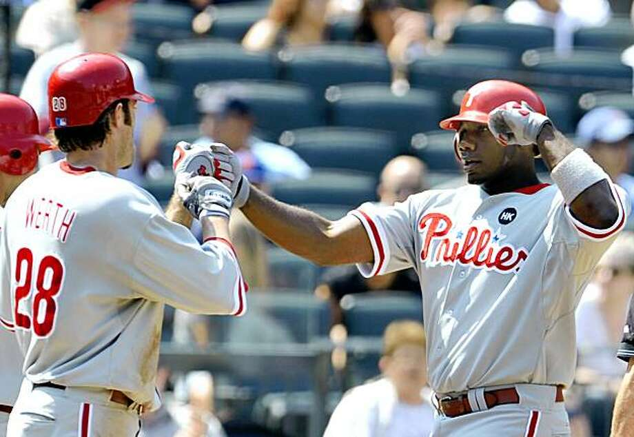 Philadelphia Phillies' Ryan Howard, right, is greeted at home by teammate Jayson Werth after hitting a two-run home run in the third inning of a baseball game against the New York Mets at Citi Field in New York, Monday, Aug. 24, 2009. The Phillies won the game 6-2. (AP Photo/Paul J. Bereswill) Photo: Paul J. Bereswill, AP