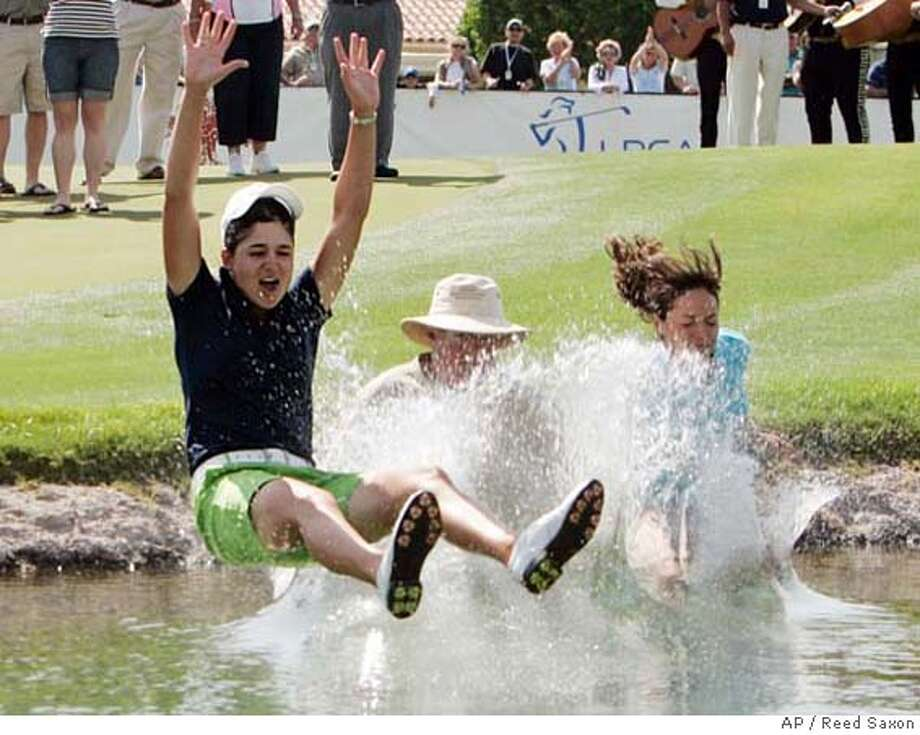###Live Caption:Lorena Ochoa of Mexico, left, is joined by family and friends in the traditional plunge into the lake alongside the 18th green after her victory in the LPGA Kraft Nabisco Championship golf tournament at Mission Hills Country Club in Rancho Mirage, Calif., Sunday, April 6, 2008. (AP Photo/Reed Saxon)###Caption History:Lorena Ochoa of Mexico, left, is joined by family and friends in the traditional plunge into the lake alongside the 18th green after her victory in the LPGA Kraft Nabisco Championship golf tournament at Mission Hills Country Club in Rancho Mirage, Calif., Sunday, April 6, 2008. (AP Photo/Reed Saxon)###Notes:Lorena Ochoa###Special Instructions:EFE OUT Photo: Reed Saxon