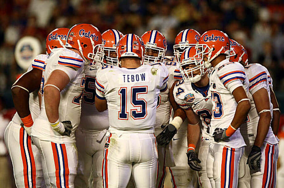 MIAMI - JANUARY 08:  Quarterback Tim Tebow #15 of the Florida Gators huddles up with his team while playing against the Oklahoma Sooners in the FedEx BCS National Championship Game at Dolphin Stadium on January 8, 2009 in Miami, Florida.  (Photo by Donald Miralle/Getty Images) Photo: Donald Miralle, Getty Images