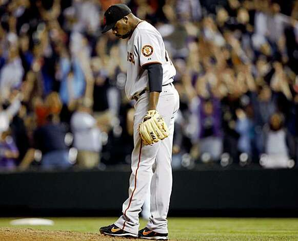 San Francisco Giants relief pitcher Merkin Valdez reacts after giving up a grand slam to Colorado Rockies' Ryan Spilborghs in the 14th inning of the Rockies' 6-4 victory in a baseball game in Denver on Monday, Aug. 24, 2009. (AP Photo/David Zalubowski) Photo: David Zalubowski, AP