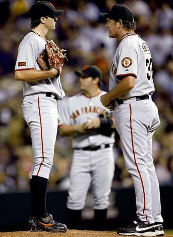 San Francisco Giants starting pitcher Barry Zito, left, confers with pitching coach Dave Righetti after Zito walked Colorado Rockies' Todd Helton with the bases loaded in the fifth inning of a baseball game in Denver on Monday, Aug. 24, 2009. (AP Photo/David Zalubowski) Photo: David Zalubowski, AP