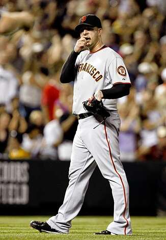 San Francisco Giants relief pitcher Justin Miller reacts after giving up a solo home run to Colorado Rockies' Todd Helton in the sixth inning of a baseball game  in Denver on Saturday, Aug. 22, 2009.(AP Photo/David Zalubowski) Photo: David Zalubowski, AP