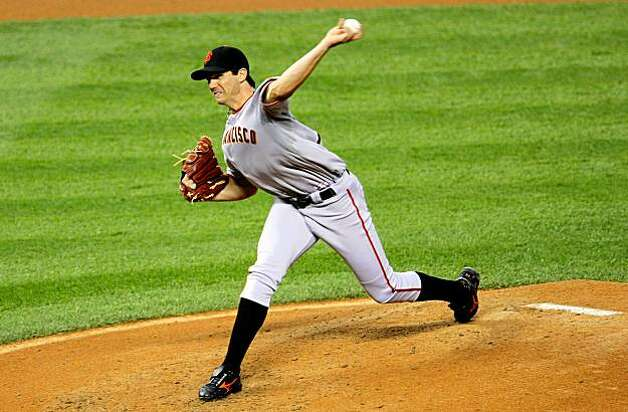 DENVER - AUGUST 24:  Starting pitcher Barry Zito #75 of the San Francisco Giants delivers against the Colorado Rockies at Coors Field on August 24, 2009 in Denver, Colorado.  (Photo by Doug Pensinger/Getty Images) Photo: Doug Pensinger, Getty Images