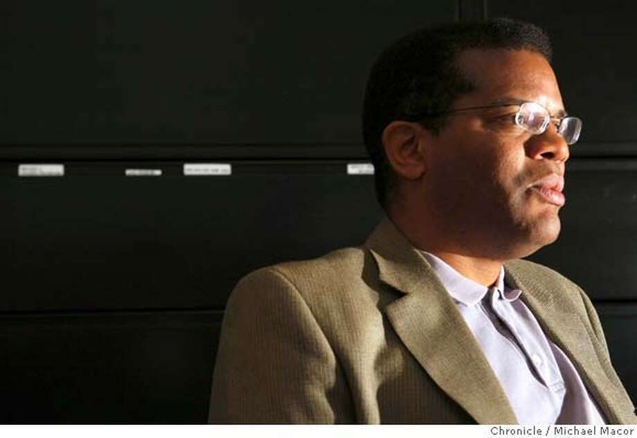 "Dr. Tony Iton, head of the Alameda County Health Services, in his downtown Oakland, Calif., office on March 19, 2008. He is part of a PBS special coming out next week called ""Unnatural Causes"". Dr. Iton believes whether or not an individual has health care insurance is far less a predictor of long-term health that many other factors, particularly education. Photo by Michael Macor/ San Francisco Chronicle Photo: Michael Macor"