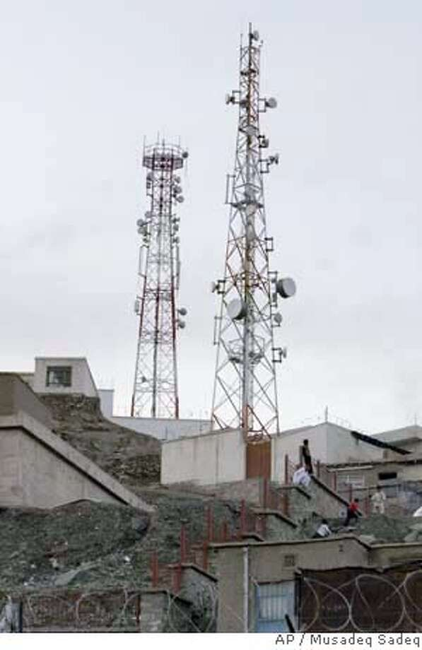 **RETRANSMITTED FOR IMPROVED QUALITY**Mobile- phone antennas are seen placed on one of the hill sides of the city in Kabul, Afghanistan on Wednesday, March 26, 2008. About 10 towers have been attacked since then _ seven of them seriously _ causing almost US$2 million in damages, the telecom ministry said. Afghanistan's four major mobile phone companies began cutting service across the south soon after. (AP Photo/Musadeq Sadeq) Photo: Musadeq Sadeq