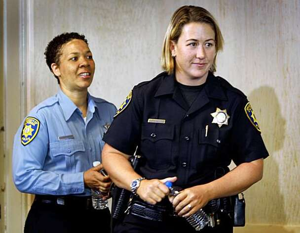 Lisa Campbell (left), manager of UCPD Special Events, and UC Berkeley police officer Ally Jacobs arrive for a news conference in Berkeley, Calif., on Friday, Aug. 28, 2009 to recall their interaction with kidnapping suspect Phillip Craig Garrido a few days before his arrest. They said Garrido raised suspicion when he arrived on campus earlier this week seeking to distribute religious material with two young girls. Photo: Paul Chinn, The Chronicle