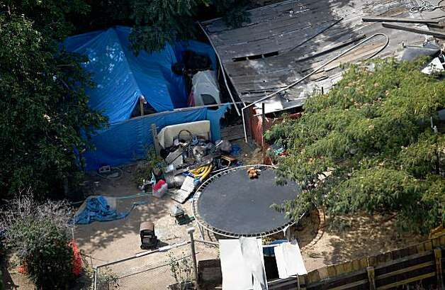 ANTIOCH, CA - AUGUST 28:  Tarps, tents and a wooden structure are seen in the backyard of alleged kidnapper Phillip Garrido August 28, 2009 in Antioch, California. Jaycee Lee Dugard was allegedly kidnapped by Phillip Garrido nearly two decades ago and was forced to live in tents and sheds behind Garrido's home with two of her children that were fathered by Garrido.  (Photo by Justin Sullivan/Getty Images) Photo: Justin Sullivan, Getty Images