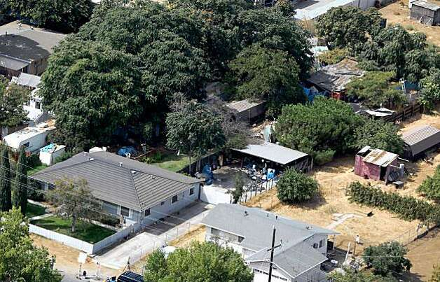 ANTIOCH, CA - AUGUST 28:  An aerial view of the home and backyard of alleged kidnapper Phillip Garrido August 28, 2009 in Antioch, California. Jaycee Lee Dugard was allegedly kidnapped by Phillip Garrido nearly two decades ago and was forced to live in tents and sheds behind Garrido's home with two of her children that were fathered by Garrido.  (Photo by Justin Sullivan/Getty Images) Photo: Justin Sullivan, Getty Images