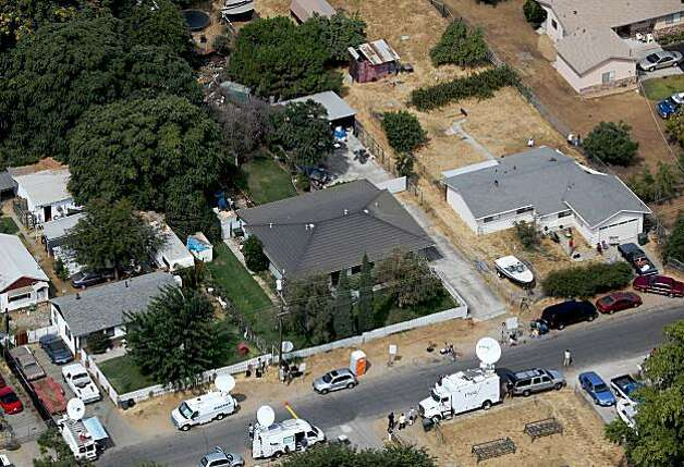 ANTIOCH, CA - AUGUST 28:  Television trucks sit in front of the home of alleged kidnapper Phillip Garrido August 28, 2009 in Antioch, California. Jaycee Lee Dugard was allegedly kidnapped by Phillip Garrido nearly two decades ago and was forced to live in tents and sheds behind Garrido's home with two of her children that were fathered by Garrido.  (Photo by Justin Sullivan/Getty Images) Photo: Justin Sullivan, Getty Images