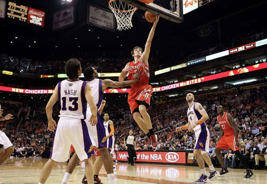 PHOENIX, AZ - FEBRUARY 09:  Goran Dragic #3 of the Houston Rockets lays up a shot against the Phoenix Suns during the NBA game at US Airways Center on February 9, 2012 in Phoenix, Arizona.  NOTE TO USER: User expressly acknowledges and agrees that, by downloading and or using this photograph, User is consenting to the terms and conditions of the Getty Images License Agreement. Photo: Christian Petersen, Getty Images / 2012 Getty Images