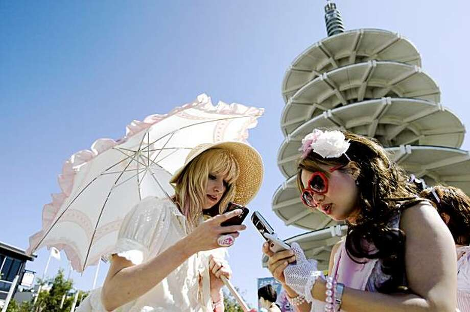 Sarah Frank and Ada exchange numbers while attending the J-Pop Summit Festival in Japantown in San Francisco on Saturday. Photo: Laura Morton, Special To The Chronicle