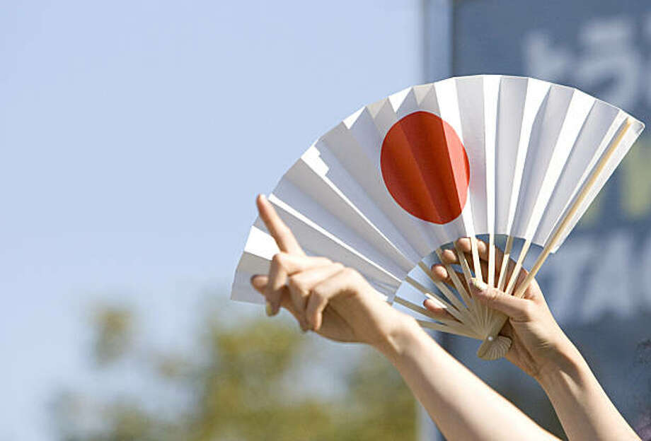 A fan waves the Japanese flag during a performance of the 6%DokiDoki girls at the J-Pop Summit Festival in Japantown in San Francisco on Saturday. Photo: Laura Morton, Special To The Chronicle