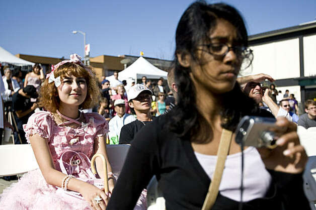 Elizabeth Simpson (left) and Rezwana Sharmin watch a performance of the 6%DokiDoki girls at the J-Pop Summit Festival in Japantown in San Francisco on Saturday. Photo: Laura Morton, Special To The Chronicle