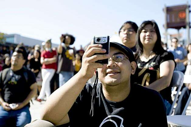 Jeremy Asuncion snaps a photo while watching a performance at the J-Pop Summit Festival in Japantown in San Francisco on Saturday. Photo: Laura Morton, Special To The Chronicle