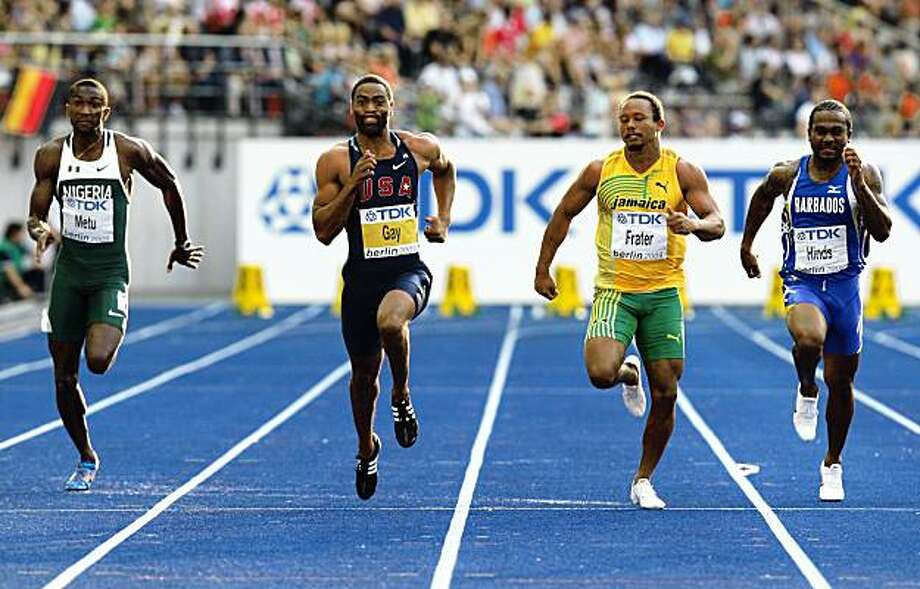 BERLIN - AUGUST 15: (L-R) Obinna Metu of Nigeria, Tyson Gay of United States, Michael Frater of Jamaica and Andrew Hinds of Barbados compete in the men's 100 Metres Quarter-Final during day one of the 12th IAAF World Athletics Championships at the Olympic Stadium on August 15, 2009 in Berlin, Germany.  (Photo by Mark Dadswell/Getty Images) Photo: Mark Dadswell, Getty Images