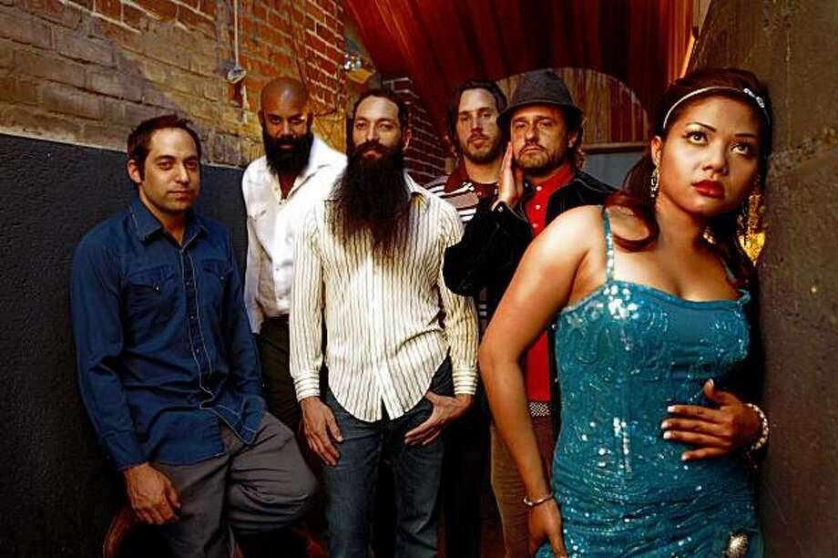 "The band Dengue Fever includes guitarist Zac Holtzman (center, with long beard) and Cambodian-born lead singer Chhom Nimol (right). Their tour of Cambodia is documented in the film ""Sleepwalking Through the Mekong."" Photo: Kevin Estrada"