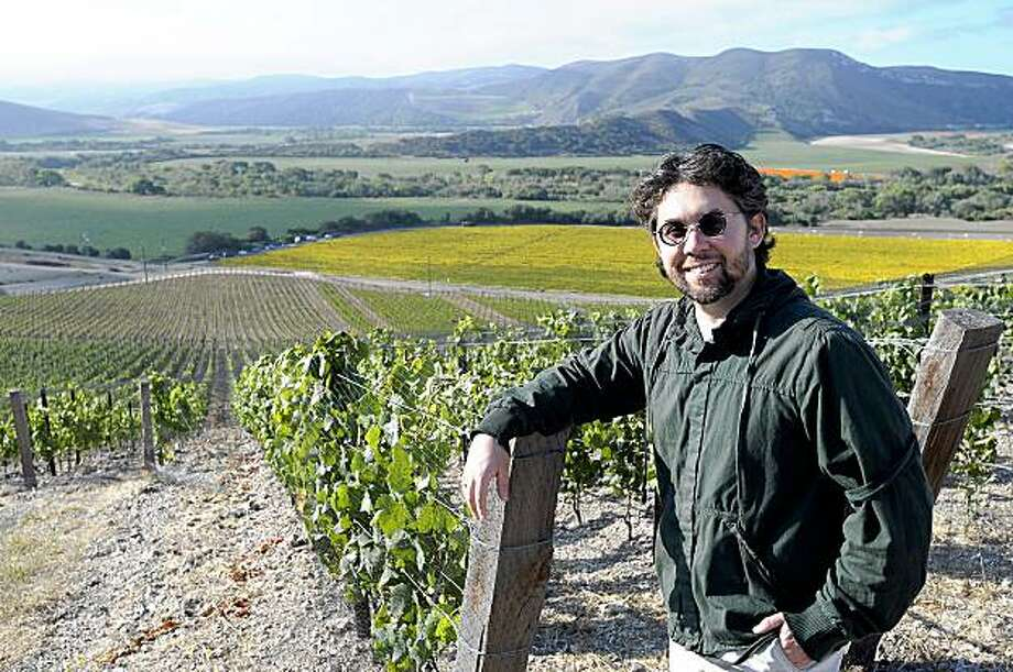 Winemaker Sashi Moorman of Stolpman wineries poses for a photo next to his vineyards in Lompoc, California on Friday, August 7, 2009. Photo/Phil Klein Photo: Phil Klein, Special To The Chronicle