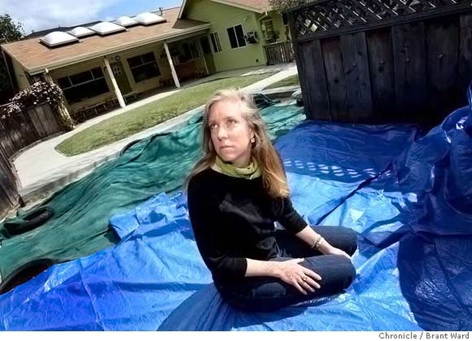 ###Live Caption:Nora Caruso sits on the tarp she will use to cover the playground area of her Santa Cruz Toddler Care Center when aerial spraying for the apple brown moth begins. She says health problems arose last year during the spraying in November 2007. She is photographed at the center Sunday, April 6, 2008. Photo by Brant Ward / San Francisco Chronicle###Caption History:Nora Caruso sits on the tarp she will use to cover the playground area of her Santa Cruz Toddler Care Center when aerial spraying for the apple brown moth begins. She says health problems arose last year during the spraying in November 2007. She is photographed at the center Sunday, April 6, 2008. Photo by Brant Ward / San Francisco Chronicle###Notes:###Special Instructions: Photo: Brant Ward