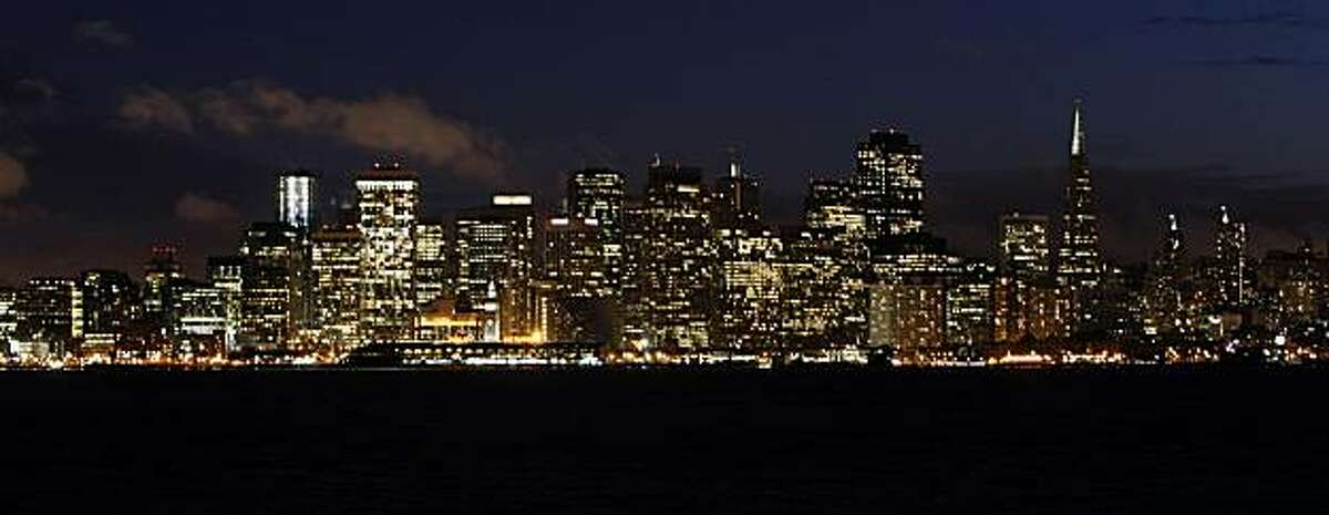 The San Francisco skyline, seen from Treasure Island on Tuesday, March 25, 2008, may look different soon if the city enacts ordinances limiting lighting after dark. Photo by Kim Komenich / San Francisco Chronicle