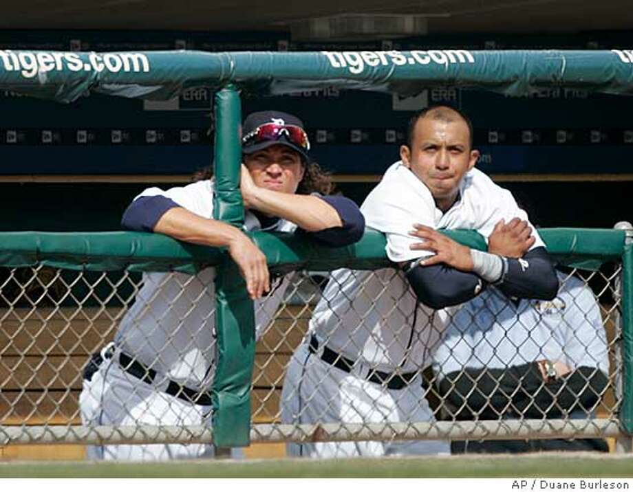 Detroit Tigers' Magglio Ordonez, left, and Carlos Guillen watch from the dugout in the ninth inning as the Tigers fall to 0-3 on the baseball season Thursday, April 3, 2008, in Detroit. The Royals beat the Tigers 4-1 to sweep the three-game series. (AP Photo/Duane Burleson) Photo: Duane Burleson