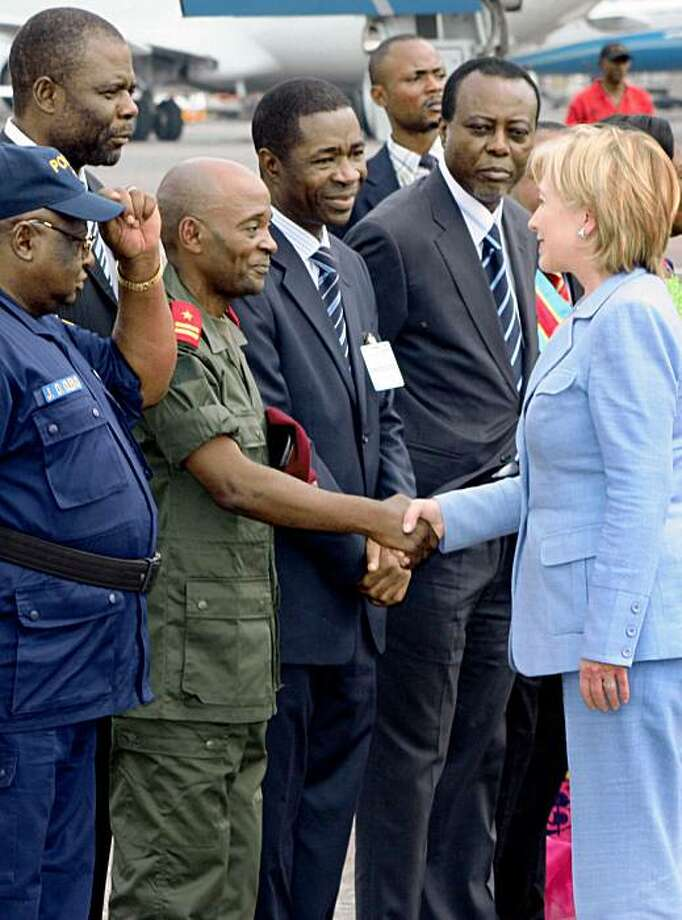 U.S. Secretary of State Hillary Clinton, right, is greeted by members of the government on arrival at the airport in Kinshasa, Congo Monday, Aug. 10, 2009. Clinton's Congo stop is the latest in an 11-day journey through Africa to promote development and good governance and underscore the Obama administration's commitment to the world's poorest continent. (AP Photo/Etienne Kokolo) Photo: ETIENNE KOKOLO, AP