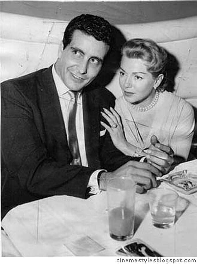 ###Live Caption:Johnny Stompanato and Lana Turner. Her 14-year-old daughter stabbed and killed him in 1958###Caption History:Johnny Stompanato and Lana Turner. Her 14-year-old daughter stabbed and killed him in 1958###Notes:###Special Instructions: Photo: Cinemastyles.blogspot.com