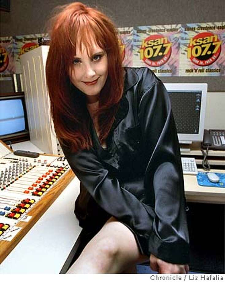 ###Live Caption:darian o'toole may 1999###Caption History:STYLE18b/C/10MAY99DD//LH--Morning DJ Darian O'Toole of 107.7 Ksan Radio, modeling a pair of black silk pajamas from Victoria's Secret.  BY LIZ HAFALIA/THE CHRONICLE###Notes:###Special Instructions:CAT Photo: LIZ HAFALIA