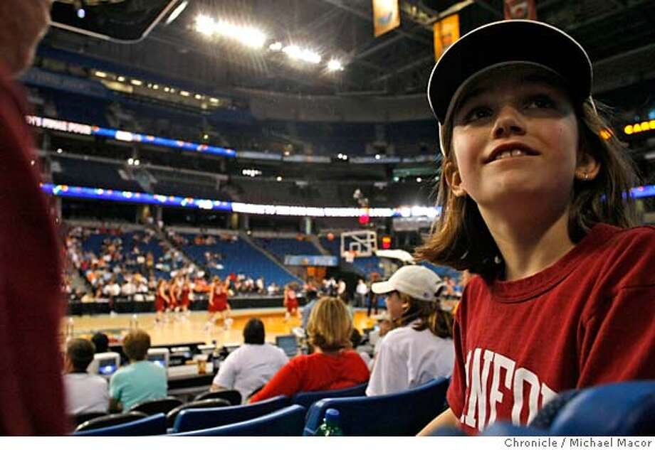 ###Live Caption:Abbey Katz, 8 and her mother Ruth travelled from Ithaca, New York to see the NCAA women's final four tournament, her mom is an alumni of Stanford University. The two watch the Stanford women during Saturday's practice at the St. Pete Times Forum in Tampa, Florida on April 5, 2008.  Photo by Michael Macor/ San Francisco Chronicle###Caption History:Abbey Katz, 8 and her mother Ruth travelled from Ithaca, New York to see the NCAA women's final four tournament, her mom is an alumni of Stanford University. The two watch the Stanford women during Saturday's practice at the St. Pete Times Forum in Tampa, Florida on April 5, 2008.  Photo by Michael Macor/ San Francisco Chronicle###Notes:The Women's NCAA Final Four Basketball Tournament in Tampa, Florida. The Stanford Cardinal women to take on University of Connecticut on April 6, 2008, in the first game of the semi finals.###Special Instructions:Mandatory credit for Photographer and San Francisco Chronicle No sales/ Magazines Out Photo: Michael Macor